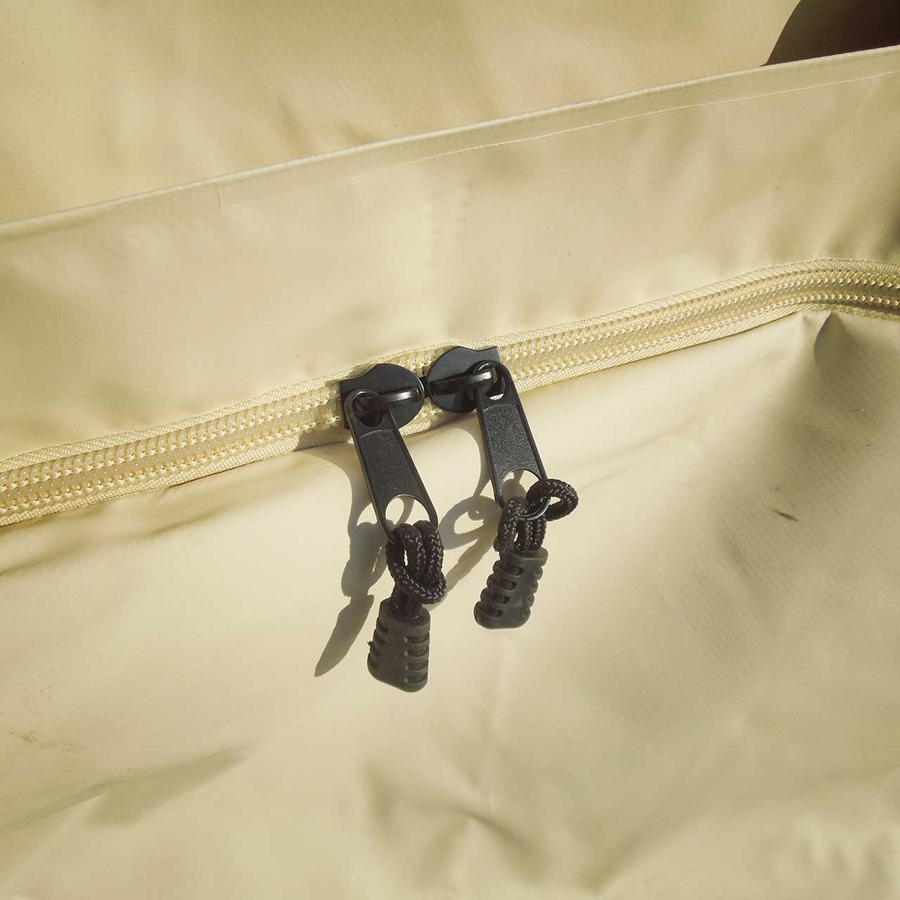 The waterproof khaki tuff truck bag's heavy duty zipper that opens on the end to load cargo and luggage into the bag to keep items dry and protected