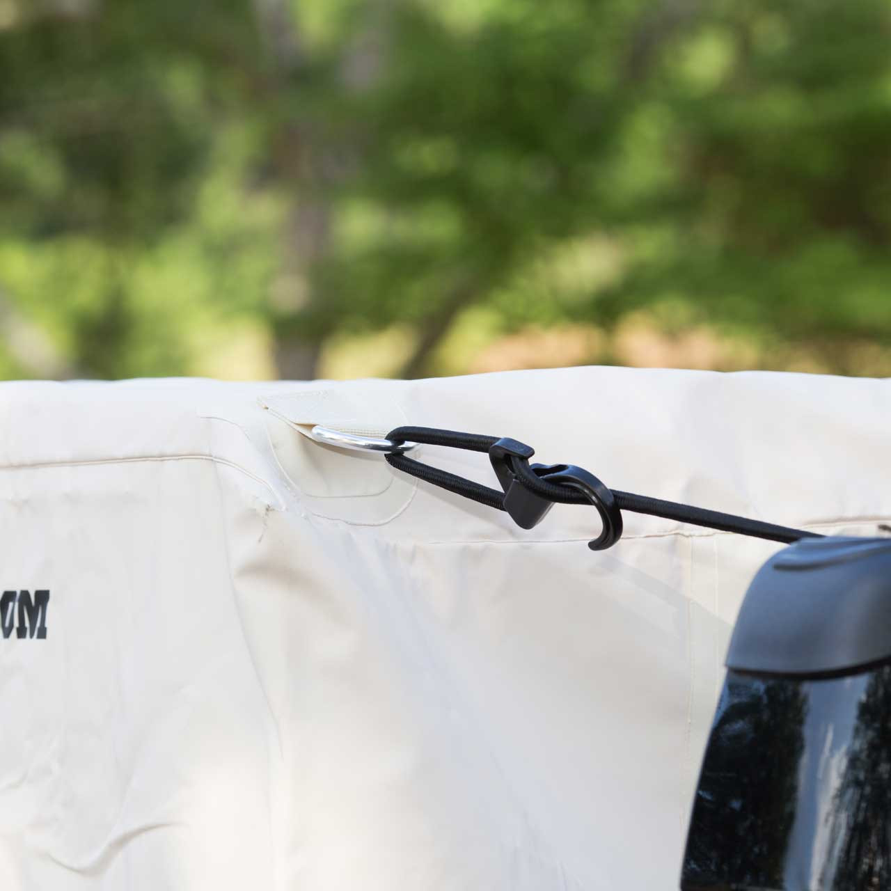 Image of the cords used to strap down and secure the waterproof khaki Tuff Truck Bag to the pickup truck bed