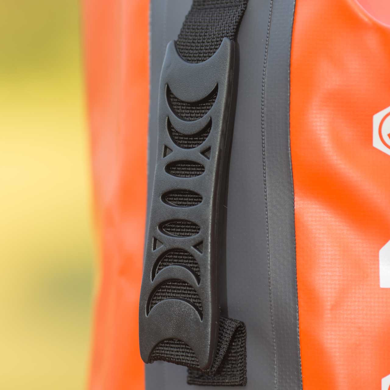 Close up of the orange Tuff Tote Bag's handle