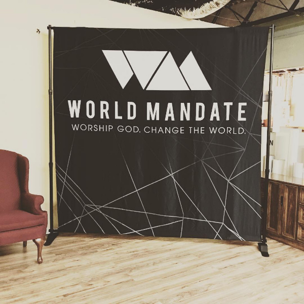aaa-8x8-worldmandate-backdrop.jpg