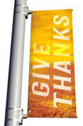 yellow Give Thanks light pole banner for fall harvest season