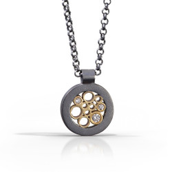 Petite Circle Pendant handmade by contemporary jewelry artist Belle Brooke Barer | Sterling silver and gold | Diamonds