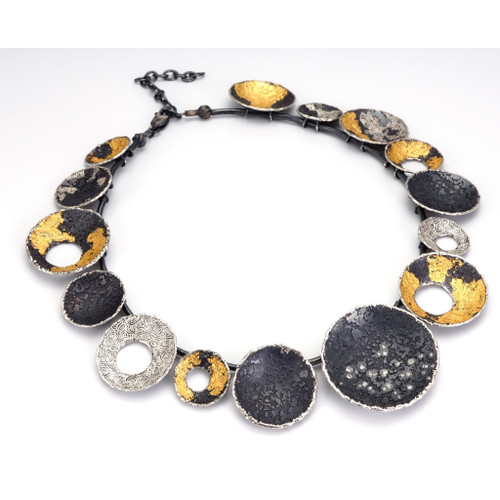 Modern Galaxy Necklace from contemporary jewelry artist So Young Park | Oxidized Sterling Silver and 24 Karat Gold Leaf | White Diamonds