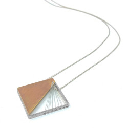 Maressa Tosto Merwarth's modern Solare Single Pendant | Reclaimed sterling silver and 14 Karat gold with silver silk thread