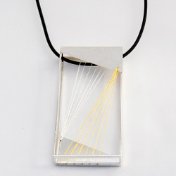 Unique Solare Reversible Pendant from Maressa Tosto Merwarth | Recycled sterling silver with silver and gold silk thread