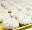 Coconut White Iced Cake Donuts