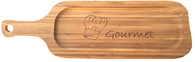 "Bamboo cutting board with ""Gourmet"" engraved 6""x0.6""x19.5""  The great price point on these Bamboo cutting boards is making them very attractive among gift basket designers!! Use this unique natural bamboo board inside your gourmet gift basket or use it as a base for making a Unique and Natural Gift Basket that any customer would love to have."