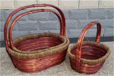 "Smallest in s/3 oval willow and seagrass baskets with handle S:12.25""X9.5""X4.5""H"