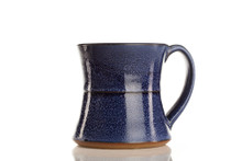 Made by Vermonter Jeremy Ayers, these hand-thrown mugs are perfect for tea or coffee. Each mug holds about 10 oz of liquid.  Available in dark blue, green, cream, and brown.