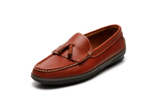 Men's handsewn Tassel Kilt Driver Loafer in Brown leather.