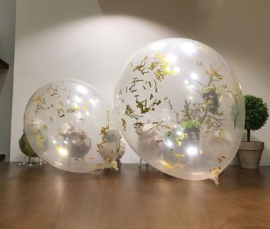 """Left: 12"""" confetti balloon Right: 16"""" confetti balloon"""