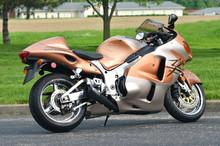 """Now fits all years of Hayabusa when using the included Spacer Kit (a $24.95 value.) Spacer kit allows a Gen 2 Hayabusa Alien Head 2 exhaust to be used on a Gen 1 Hayabusa (99-07) without any permanent modification. Spacer kit not required for Gen 2 models.  14"""" megaphone muffler Black ceramic coated finish High flow flange kit Maximized power gains on stock and modified engines 2.25"""" outlet permanent baffle Larger diameter outlet provides increased exhaust flow Distinctive look/aggressive sound (2.25"""" optional noise reduction insert sold separately) No fairing modifications required Aerospace quality, ultra lightweight stainless construction Includes (Emissions/PAIR) Block Off Cap and instructions for decel-pop reduction 3oz. tube of Permatex Ultra Copper® supplied with  exhaust system purchase Includes Brock's lifetime direct support package  At no additional charge Select from increased drivability/fuel mileage (pump gas) or race-proven (race fuel) track maps via our map support program  At no additional charge Click here to view logo plate color options"""
