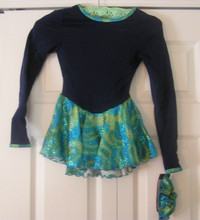Mondor Model 4404 Skating Dress   Color :Blue top with mosaic skirt  or Blue top with blue ice skirt   53% polyester - 38% nylon - 9% Lycrar elastane   Skirt and cuff and neck: 80% nylon - 20% elastane  Long sleeve dress  Printed classic skirt  Printed bias on neckline and cuff  Hair tie included
