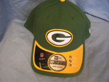 New Era Green Bay Pakers 39 THirty On Field FLex Hat    Color: Green hat, yellow brim with green trim Material: 95% polyester 5% spandex Description: Official On Field 2015 Sideline Hat Front Stitching: Packers logo Side Stitching: New Era logo on left side Back Stitching: NFL shield