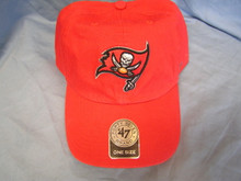 "47 Brand Tampa Bay Buccaneers NFL Clean Up Strapback Hat  Garment washed for a broken-in look and feel, this red low-crown relaxed baseball cap is constructed of quality cotton twill detailed with raised embroidery of the Tampa Bay Buccaneers NFL logo.     Approx. 4 1/2"" Crown, 6-Panel 2 3/4"" Pre-Curved Bill     Made of: 100% Washed Cotton Twill     Classic 6-Panel Crown Sewn Eyelets - For Ventilation Raised Team Logo Embroidery Embroidered '47 Brand Side Hit Sewn Team Logo Tab Self-Fabric Adjustable Strap w/ Snap Brass Buckle     Size: Adjustable - Adjusts via fabric strapback to fit up to size 7 5/8 (XL) comfortably."