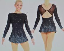 Mondor Model 12933 Skating Dress  Glitter dress, Mesh back neckline, Butterfly closure, Flat skirt, Matching hair tie included Fabric: 80% nylon, 20% elastane Mesh: 80% polyester, 20% elastane
