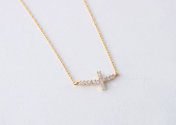 Yellow gold sideways cross necklace sterling silver kellinsilver yellow gold swarovski curved sideways cross necklace sterling silver from kellinsilver mozeypictures Images