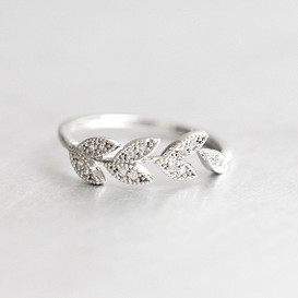 CZ Olive Leaf Wrap Ring White Gold from kellinsilver.com