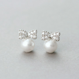 Tiny Cz Bow Pearl Stud Earrings White Gold from kellinsilver.com