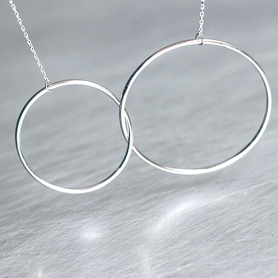 Sterling Silver Outline Circle Knot Necklace White Gold from kellinsilver.com