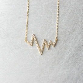 CZ Yellow Gold Heartbeat Necklace Sterling Silver from kellinsilver.com