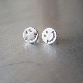 White Gold Smile Stud Earrings from kellinsilver.com