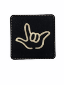 "DRINK COASTER SQUARE PAD SIGN LANGUAGE OUTLINE HAND "" I LOVE YOU""  ( BLACK BACKGROUND / GOLD HAND) LEATHER"