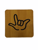 "DRINK COASTER SQUARE PAD SIGN LANGUAGE OUTLINE HAND "" I LOVE YOU""  ( BAMBOO BACKGROUND / BLACK HAND) LEATHER"