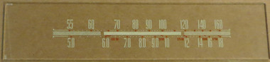 Dial image taken against a tan/brown background to better illustrate off-white dial print. Dial glass is clear other than scale print.