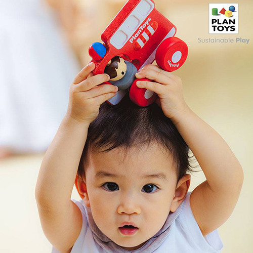 wooden-toy-fire-truck-plan-toys-with boy