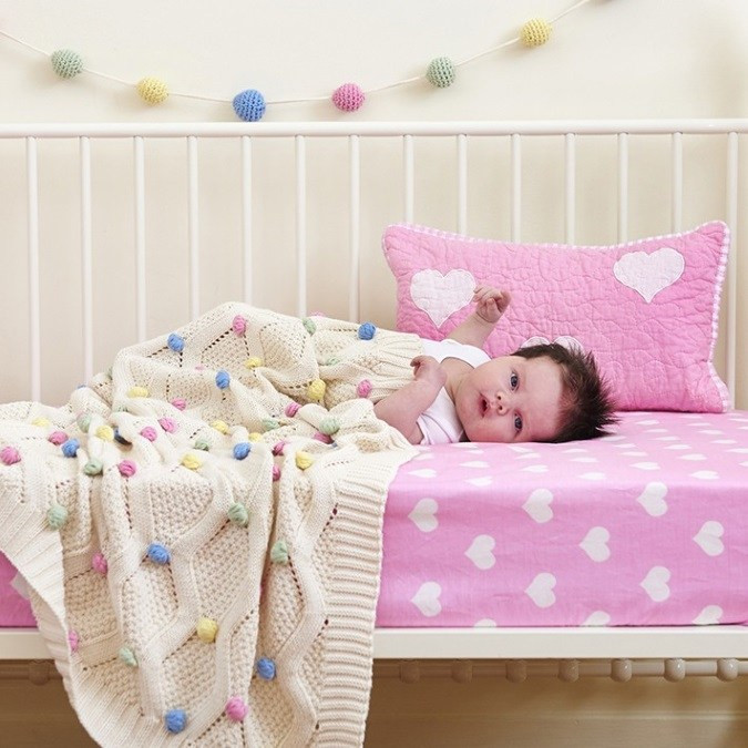pastel-pompom-baby-blanket-with-garland