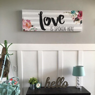 'Love is Spoken Here' canvas art