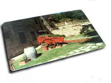 Custom hardboard photo placemat with rounded corners with image of herb-filled Tuscan wagon.