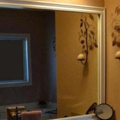 The Chelsea mirror frame kit was featured in this bathroom update project