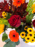 A beautiful fresh mix of seasonal blooms in autumnal shades