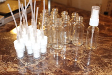 12 boston round glass bottles with atomizers