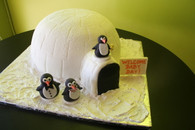 Fondant covered cake. Handcrafted fondant penguins, daddy, mommy, baby, so cute! Servings: 40