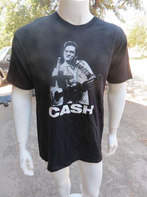 Front: Cash. Johnny Cash, as in the flippin' legend. R.I.P. Don't wear this one to brunch at your mama's on Sunday. Back: BLANK. 'nuf said.