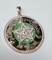 Beautiful 1inch pink Saphire and emerald cz Silver Star Medallion