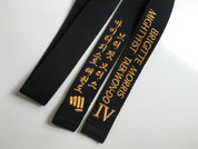 Black belt with gold embroidery. This is an example of a belt with 3 additional lines (the fist is considered as an additional line).