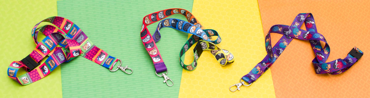 Photo banner of three colourful lanyards on a green yellow and orange background