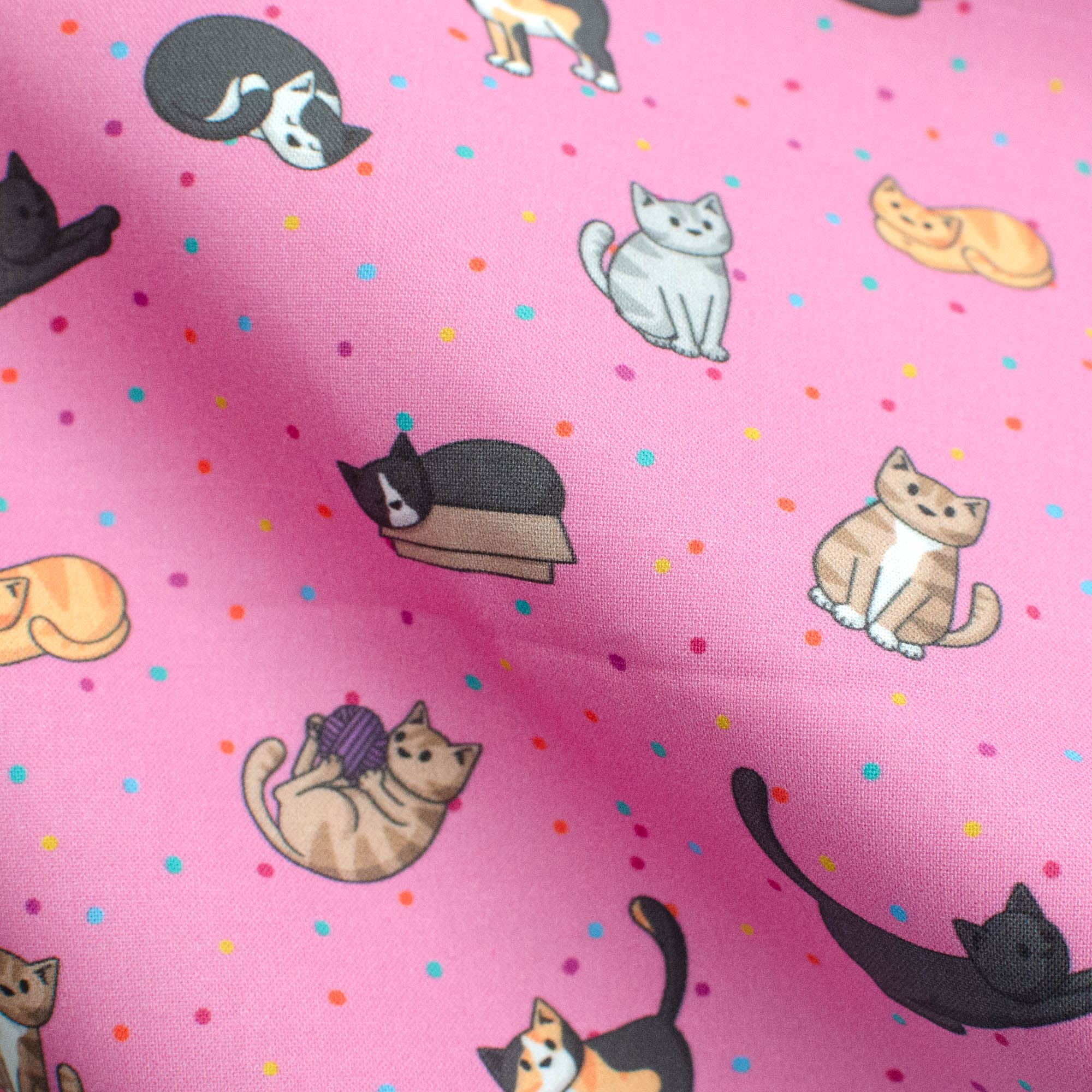 Doodlecats on pink fabric
