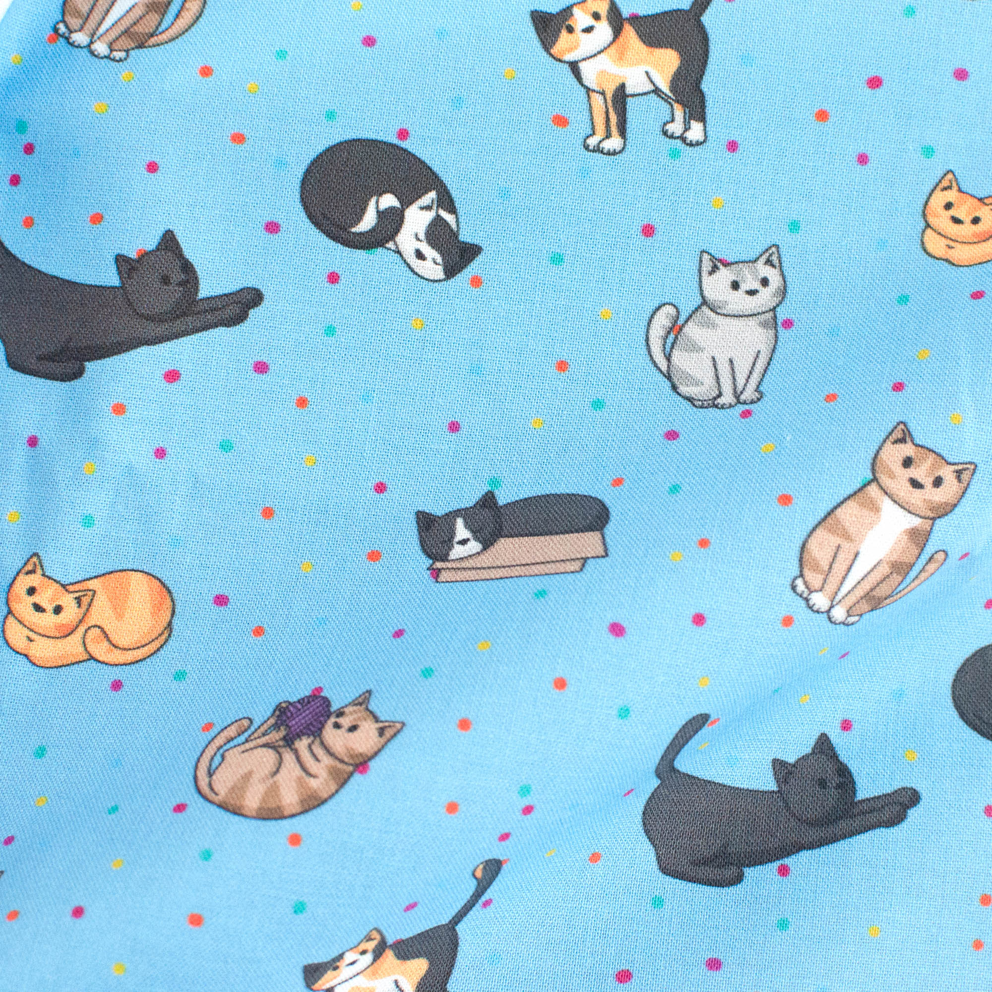 Doodlecats on pink fabric with colourful dots