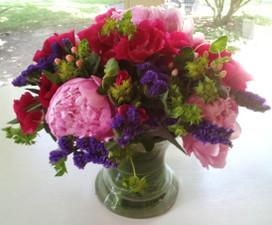 Peony bouquet Summertime is when beautiful peonies are available in the markets. We combine these with gorgeous botanicals such as hypericum berries and statice to make a bouquet of textures and colors she will never forget! - Flowers Shops Northbrook IL - Jan Channon Flowers