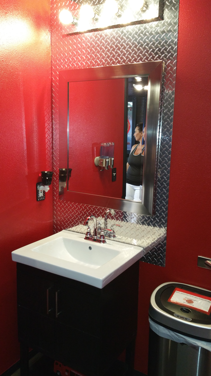 Add some light to a dark space by using diamond plate behind the mirror.