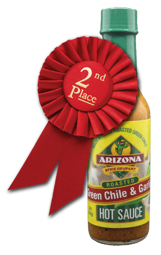 Medium heat Roasted Green Chili from Hatch NM and plenty of garlic.  Low in the vinegar taste and versatile on uses.  Great on steak, chops, chicken, cheese crisp and just about everything else.
