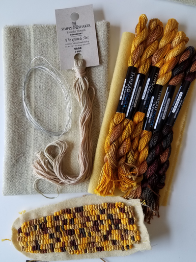 """This is the small corn cob, still in process, but showing how the two variegated threads work up to a realistic corn cob!  Please note that if you have looked at our pattern entitled """"a-MAIZE-ing il-LUMINA-tion"""" THIS is the same gold thread combination used to make ITS Indian corn!  KIT includes well-felted pale yellow wool, plus a total of 6 skeins of thread to complete the cob; as well as the wool, wire and thread for the husks."""