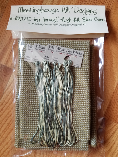 Felted wool and hand-dyed threads for Husks.