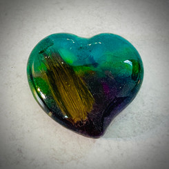 large heart, deep technique  using green, cerulean blue, and purple with a lock of hair added