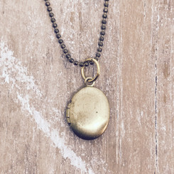 tiny brass locket